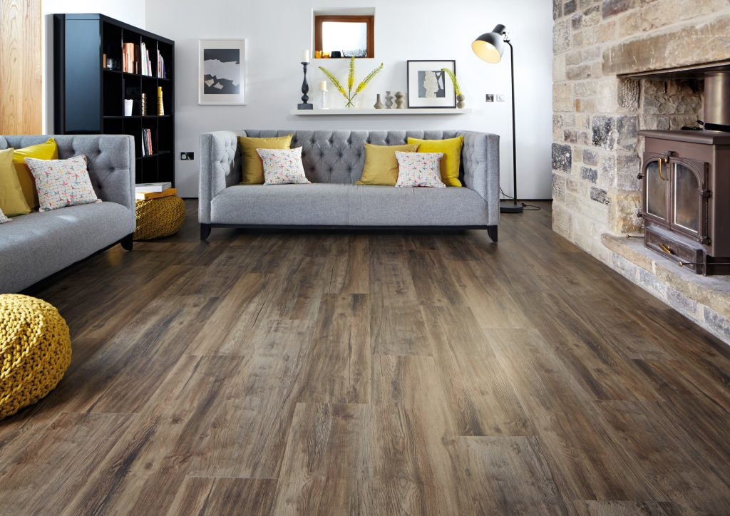 Vinyl plank flooring in a living room with two couches and a fireplace