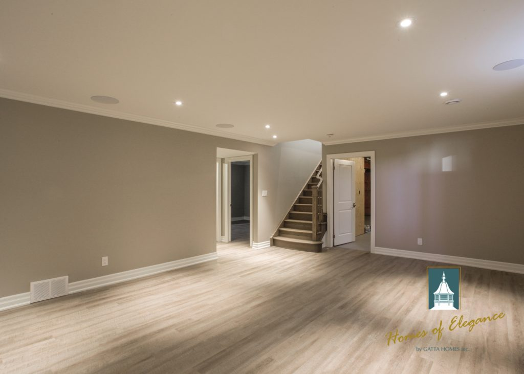 Luxury vinyl flooring in a finished basement with no furniture