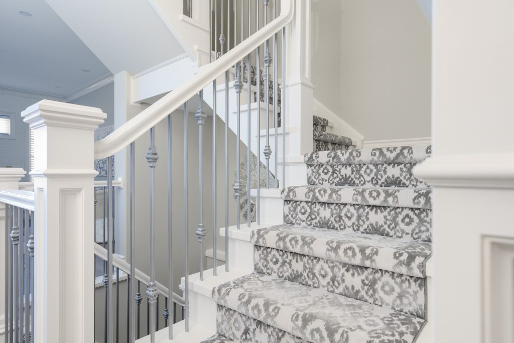 A patterned carpet stair runner.