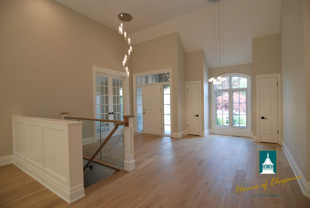 The main floor of a model home showing off solid hardwood flooring
