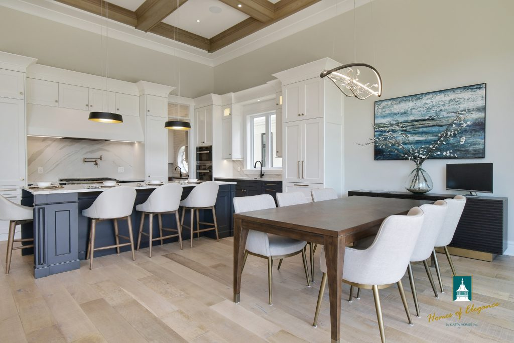 A kitchen and dining area with hardwood floors