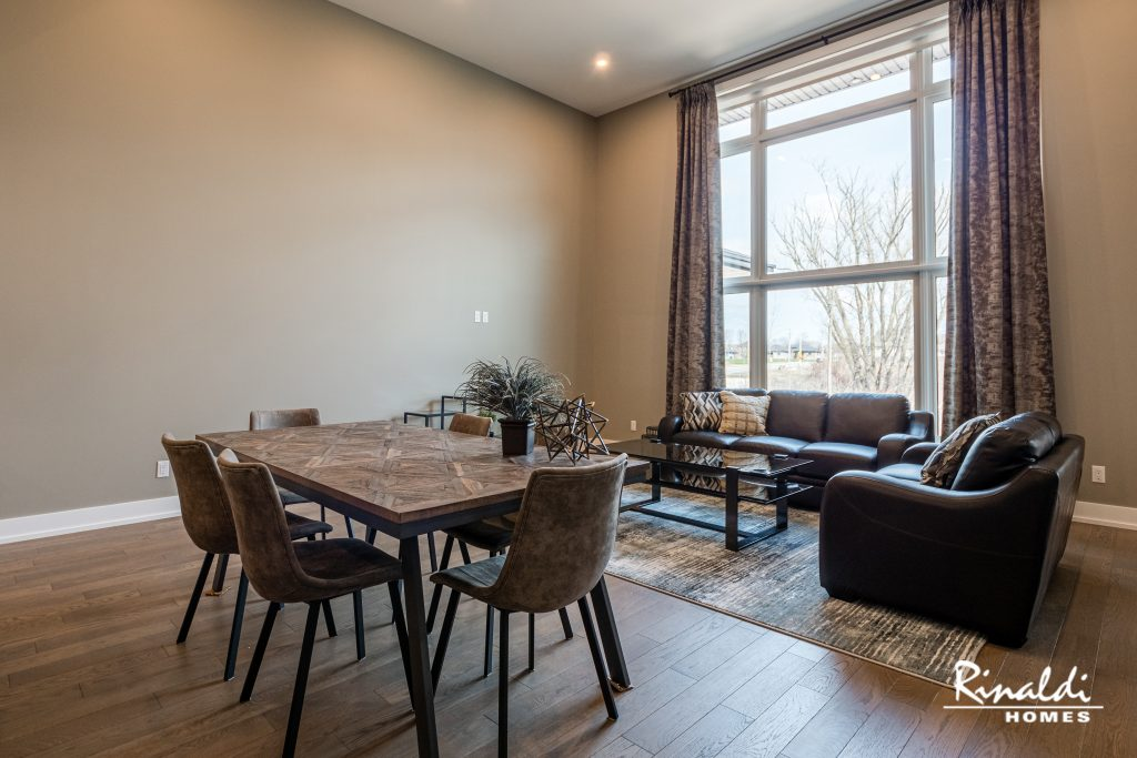 A furnished living area and table with hardwood flooring