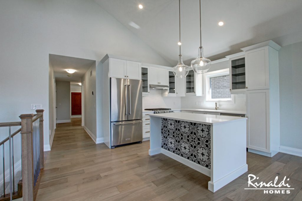 A kitchen in a model home with engineered hardwood flooring